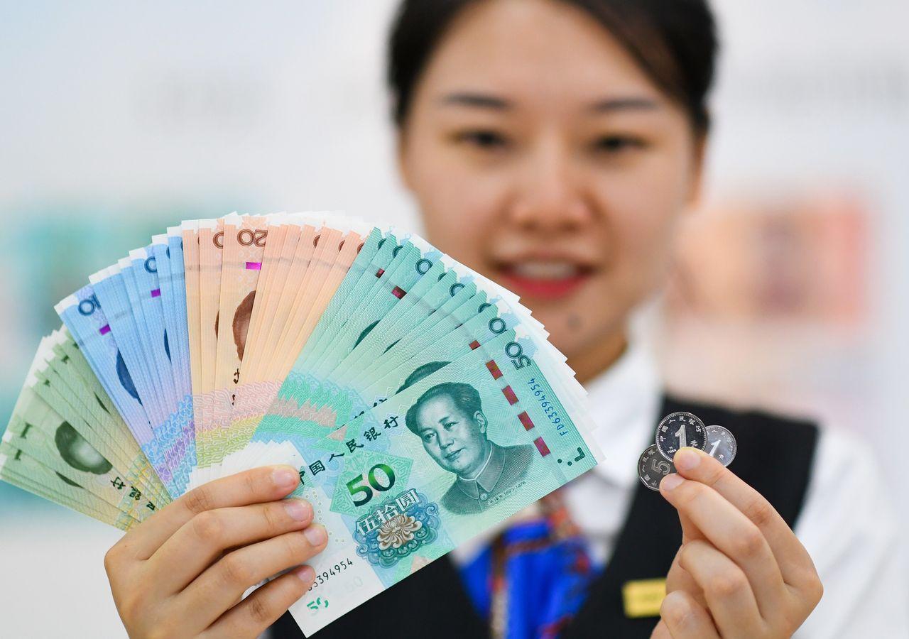 الآثار العالمية لتخفيض الصين قيمة اليوان عام 2015
